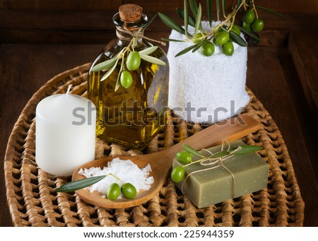 Spa still life with soap,salt, cosmetic oil and green olives - stock photo