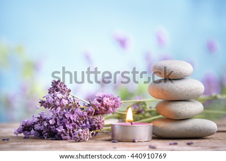 Spa still life with stack of stones,burning candles and lavenders - stock photo