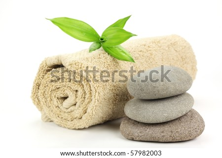 Spa still life with stacked of stone and towel - stock photo