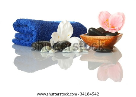 spa still life with towel and flower showing wellness concept