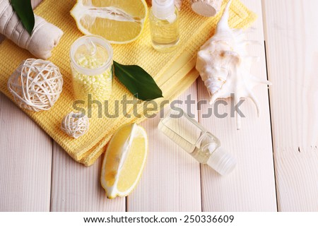Spa still life with towel on wooden planks background - stock photo