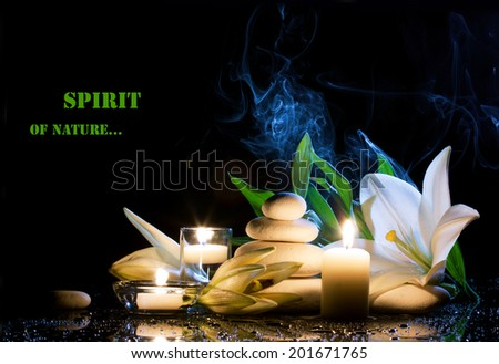spa still life with white lily, stones and  burning candles on  black bright table with water drop,  dark background - stock photo