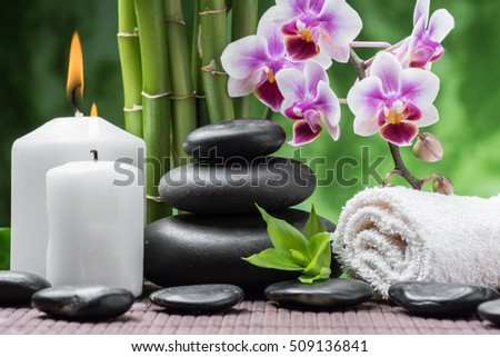 spa still life with zen basalt stones ,orchid and bamboo with candle