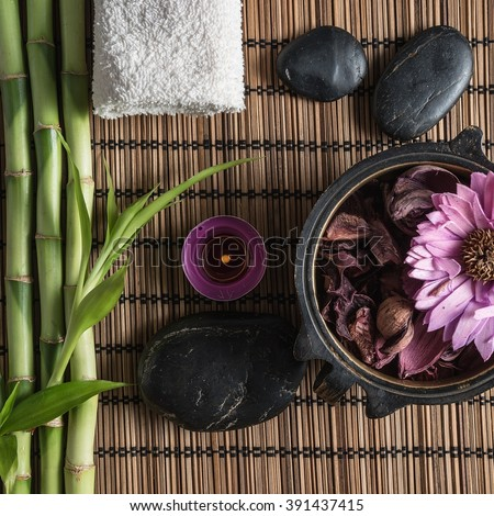 spa still life with zen basalt stones ,votive candle and  bamboo  - stock photo