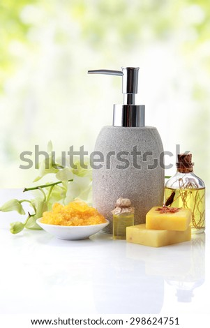 Spa still life with zen stone, essential oil, candle and pump container - stock photo