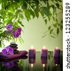 Spa still life with zen stones aromatic candles and orchids - stock photo