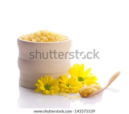 spa still with sea salt in wooden jar and yellow flowers isolated on white - stock photo