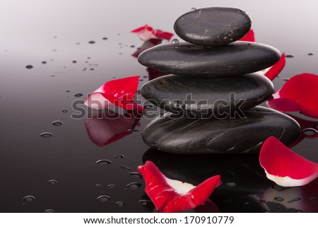 Spa stone and flower petal still life. Healthcare concept. - stock photo