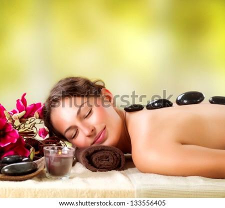 Spa Stone Massage. Beautiful Woman Getting Spa Hot Stones Massage in Spa Salon. Beauty Treatments Outdoor. Nature - stock photo