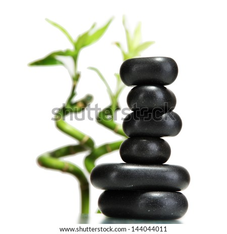 Spa stones and bamboo isolated on white