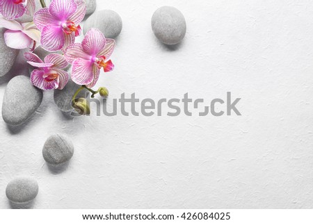 Spa Stones and Orchid flowers on paper