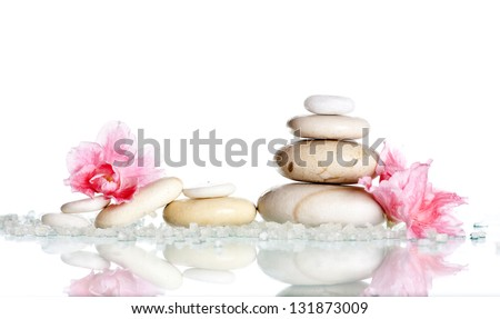 Spa stones and pink flower on white - stock photo