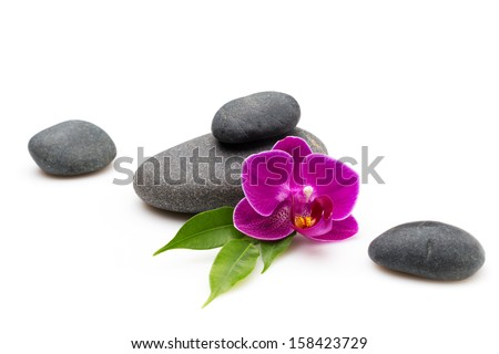 Spa stones and pink orchid isolated background. - stock photo