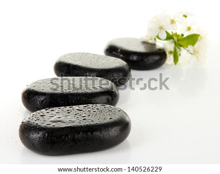 Spa stones and white flowers isolated on white - stock photo