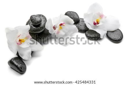Spa stones and white orchid isolated on white