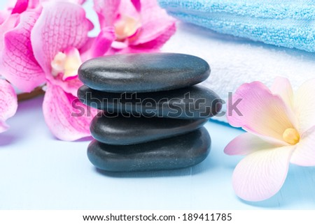 Spa stones, flowers and towels, selective focus, close-up