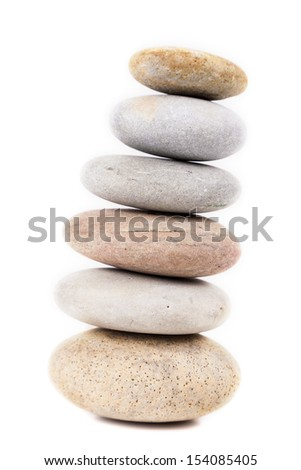 Spa stones in pyramid isolated on white background - stock photo