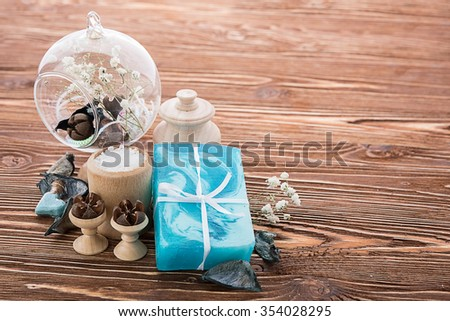 spa stuff on wooden background: candle, aroma - stock photo