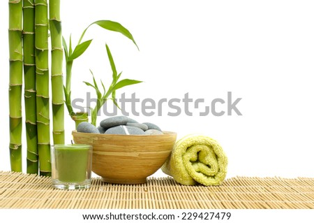 Spa style with towel with Bamboo, bowl of Stones and candle - stock photo