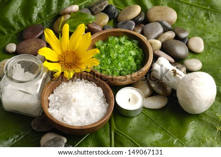 spa supplies with yellow orchid . salt in bowl ,image of tropical spa. - stock photo