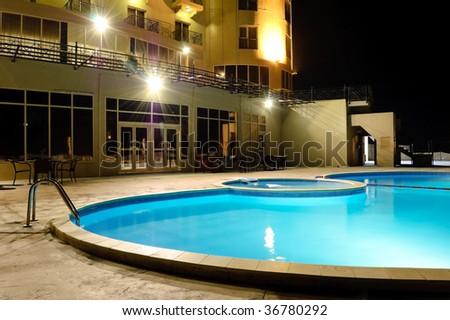 SPA swimming pool in night illumination, UAE - stock photo