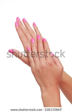 Spa theme woman hand with lovely pink manicure over white background - stock photo