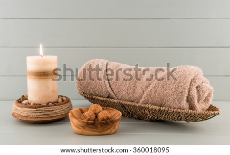 Spa Towel with Bath Bombs and Candle - stock photo