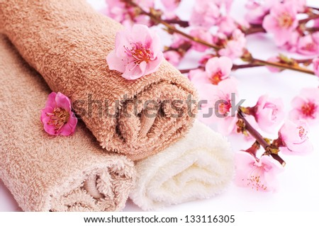 Spa towels with cherry flowers - stock photo