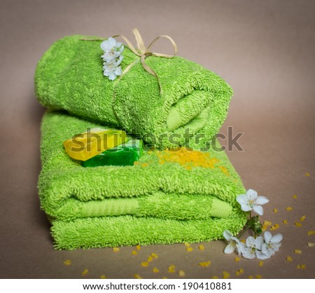 Spa towels with flowers, aroma soap and salt. - stock photo