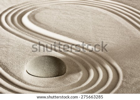 spa treatment concept japanese zen garden stones tao buddhism conceptual for balance harmony relaxation meditation wellness background harmony and purity stone stack sand pattern spiritual elements  - stock photo