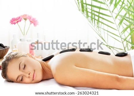 Spa Treatment. Relaxing Hot Stone Treatment - stock photo