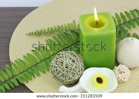 Spa treatment setting with green theme