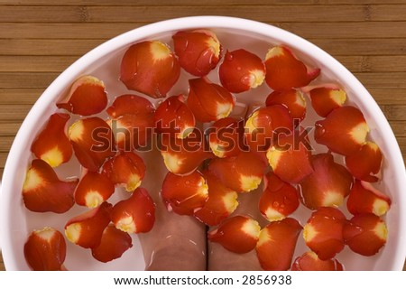 Spa Treatment with aromatic rose petals - stock photo