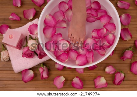 Spa Treatment with aromatic roses, petals, and candle