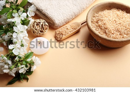 Spa treatment with blooming branch on beige background