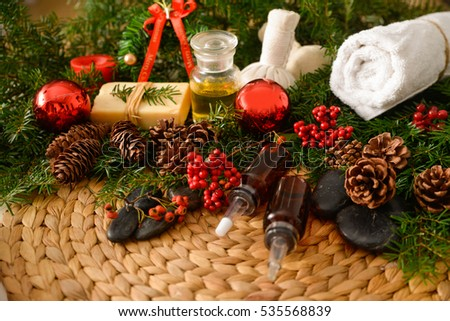Spa treatment with Christmas decorations on wicker woven mat