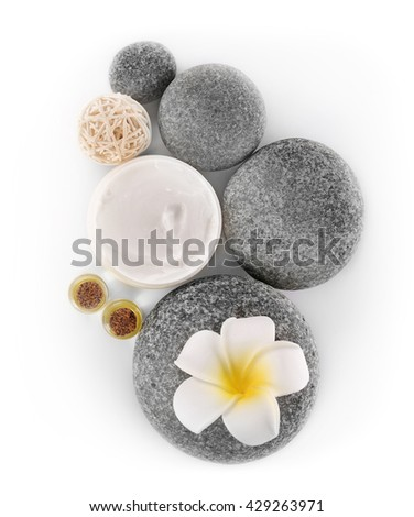 Spa treatment with stones and cream isolated on white - stock photo