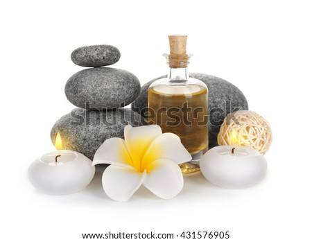 Spa treatment with stones and oil, isolated on white - stock photo