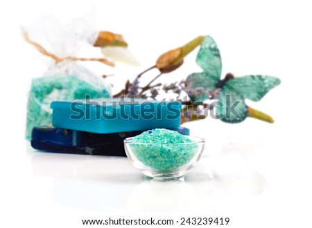 Spa treatment with turquoise bath salts, on white background - stock photo