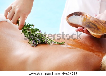 Spa Treatment - woman undergoing  spa treatment with olive oil and herbs. - stock photo