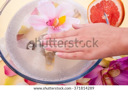 spa treatments for female hands. beautiful female hand during Spa treatments - stock photo