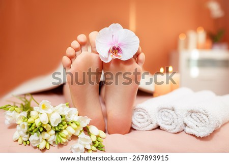 Spa treatments for the feet. orchid flowers - stock photo