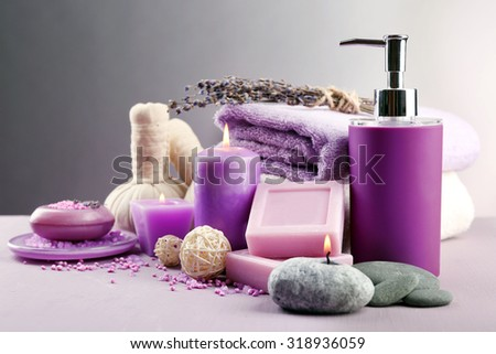Spa treatments isolated on colorful background. Lavender spa concept - stock photo
