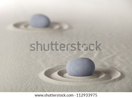 spa wellness background with round stones and sand like in Japanese zen garden for meditation and relaxation to find spiritual balance and purity - stock photo