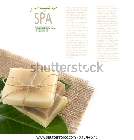 Spa wellness setting with natural soaps.  Variety of homemade soaps on a green leaf. - stock photo