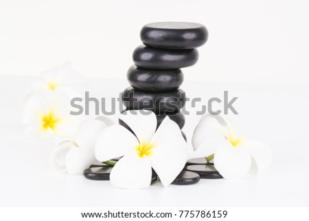 Spa with basalt stones and Frangipani flowers on white background