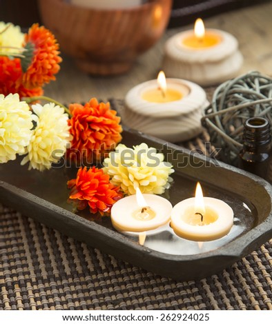 Spa with Floating Burning Candles in a Wooden Water Bowl, Beautiful Calm Setting - stock photo