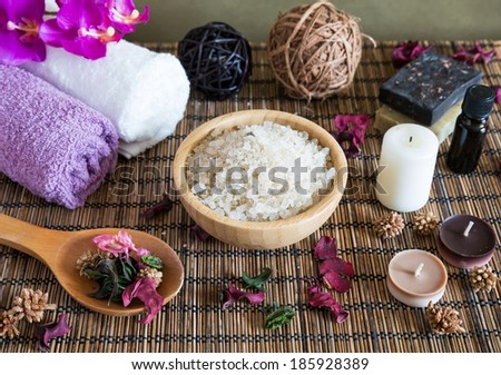 Spa with natural bath salt, candles, soap, towels and petals