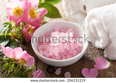 spa with pink herbal salt and wild rose flowers - stock photo