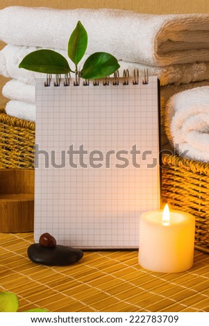 Spa with towels with a candle and pad - stock photo